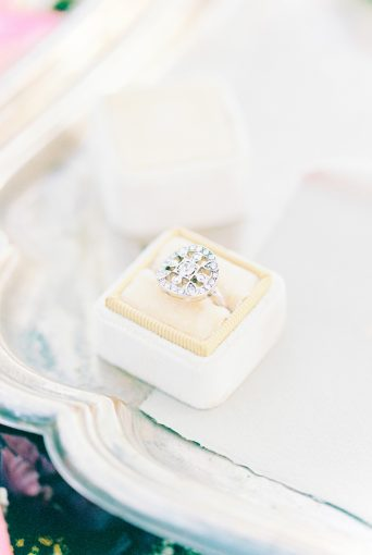 beautiful engagement ring sat within a velvet ring box