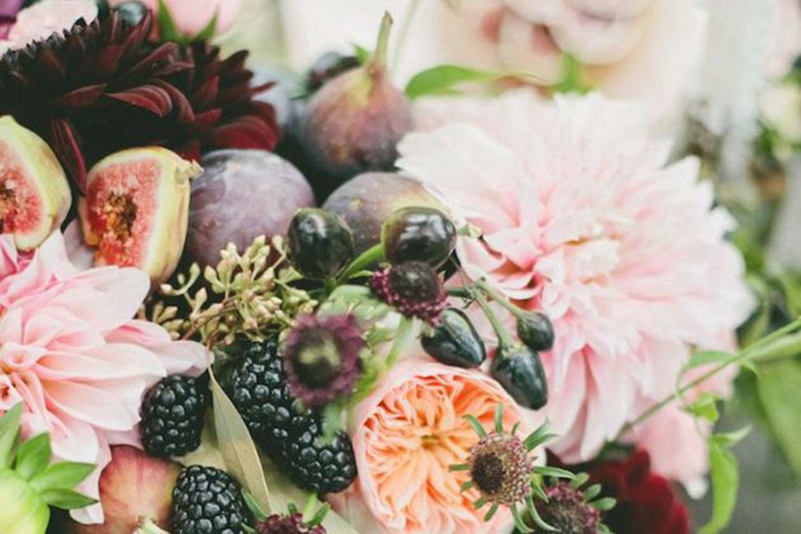 beautiful wedding flower arrangement with berries and figs