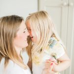 mother and daughter giggle