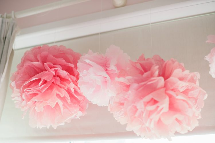 pink paper pom poms to decorate for baby coming home