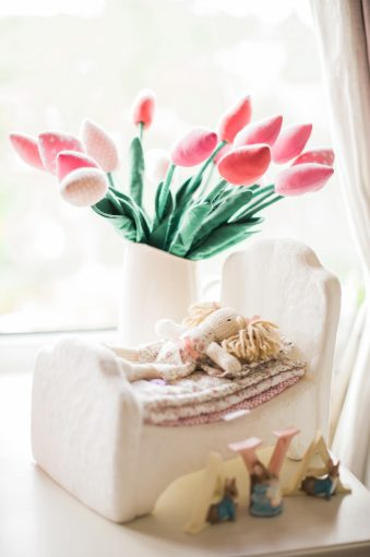 tulips and child's doll toy