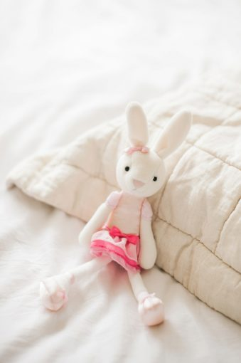 child's cute bunny soft toy wearing a pink dress