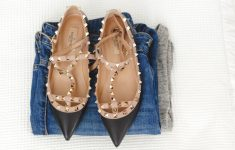 fashion flatlay image with jumper denima jeans and pointed flat shoes