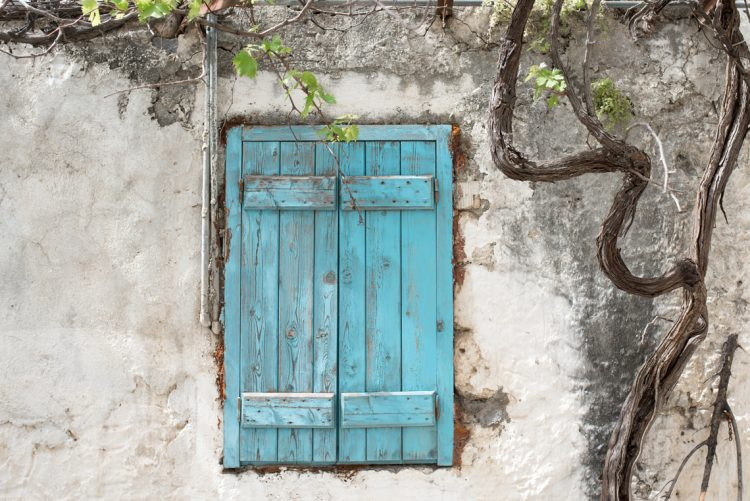 whitewashed buildings and blue doors of the aegean islands