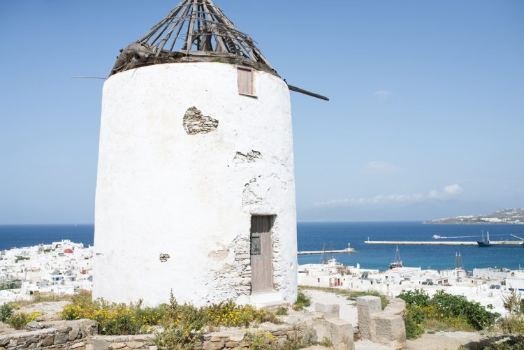 ruin of an old windmill in the aegean islands
