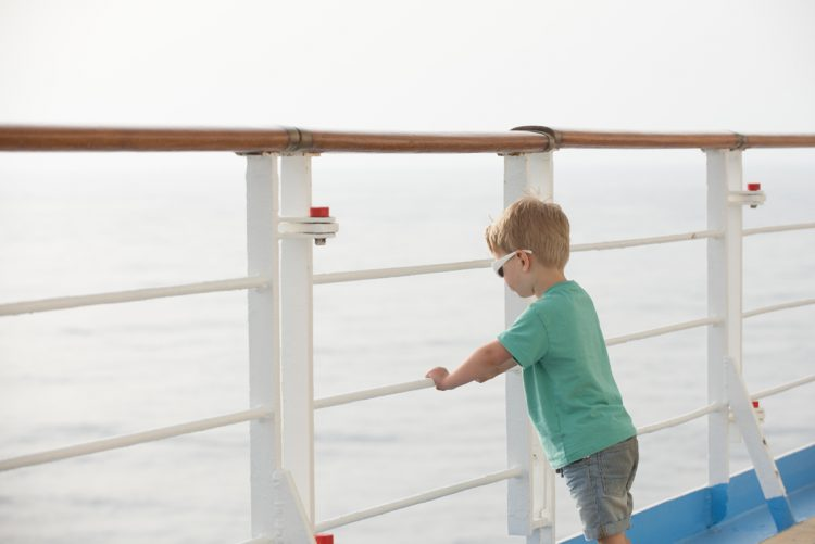 on board a cruise liner sailing out to sea
