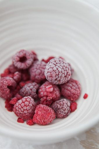 bowl of rapserries ready to make raspberry coulis