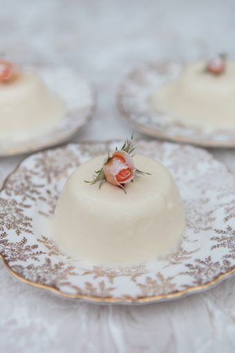 panna cotta recipe with a pink rosebud displayed on top