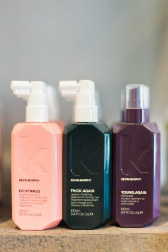 hair care and styling products in bright packaging at the blush and blow salon