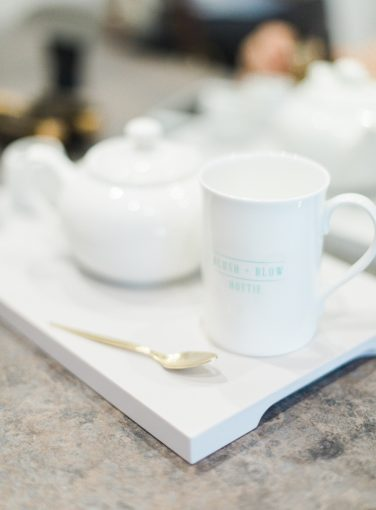 tea set at the Blush and Blow salon london with a gold teaspoon