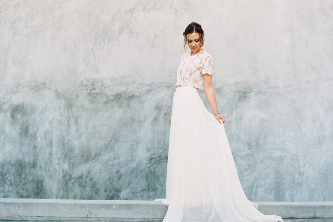 bride wearing two piece wedding dress by alexandra grecco