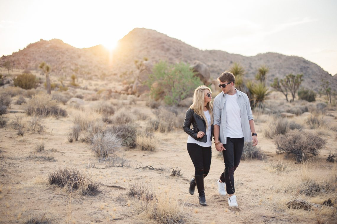 couple walking amongst the joshua trees