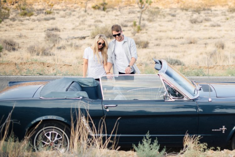 couple with vintage ford mustang by the joshua trees