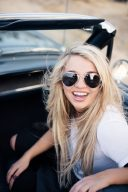 woman in vintage ford mustang wearing sunglasses