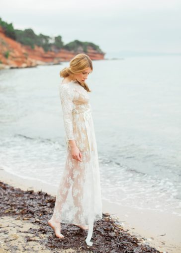 sheer lace wedding gown iinspiration set on a beach