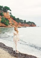 lace gown bridal style on the beach of a secret cove in greece