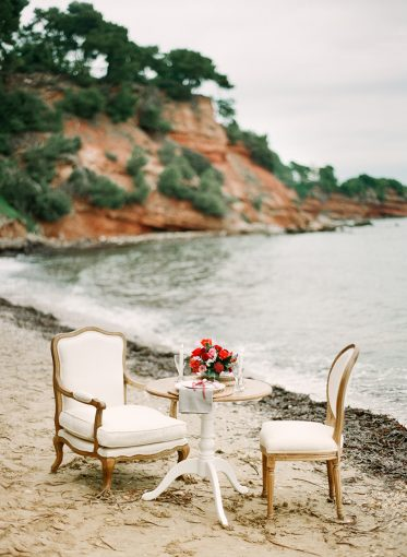 secrect cove greek beach wedding decor insipiration small table and chairs setting