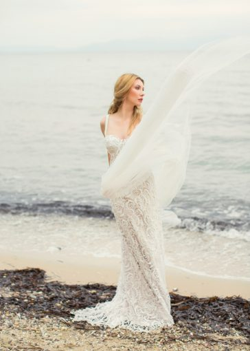 ethereal bridal style with lace wedding dress set on a beach in greece