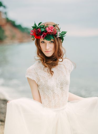 pretty bridal style and lace wedding dress wearing a floral crown