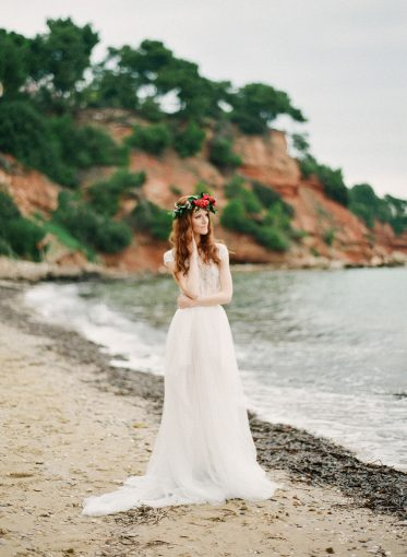 bridal style shoot with floral crown in a secret cove setting