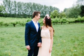 couple holding hands wearing more formal oufit for their engagement session outdoors
