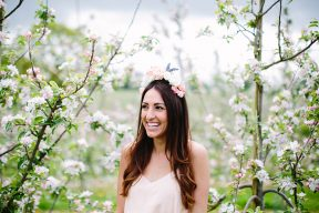 bride to be amongst the blossom trees wearing a floral crown