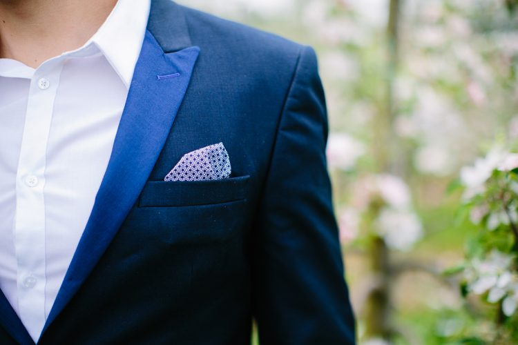 smart navy suit with pocket square