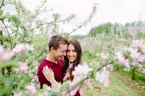 engagement session couple through the blossoms