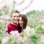 engagement session couple in the blossom trees