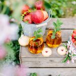 picnic styling with drinks, apples, strawberries and a cute crate
