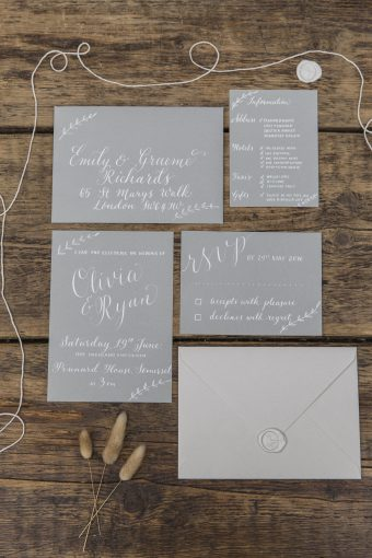 soft grey and white calligraphy wedding stationery with envelope and wax seal