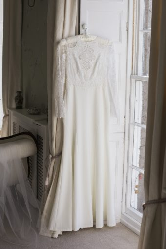 wedding gown hung by the window of pennard house