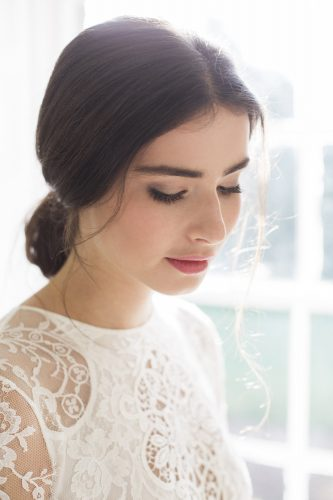 natural bridal makeup with a classic rose lip colour and low loose bun hairstyle