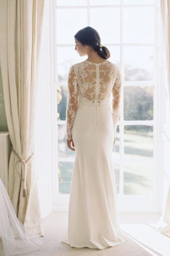 heavily detailed lace back of wedding gown from luellas bridal