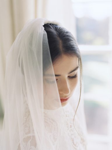 bridal portrait wearing a veil waiting for her wedding