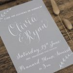 soft grey and white calligraphy wedding stationery