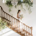 bride descending the old wooden staircase of pennard house