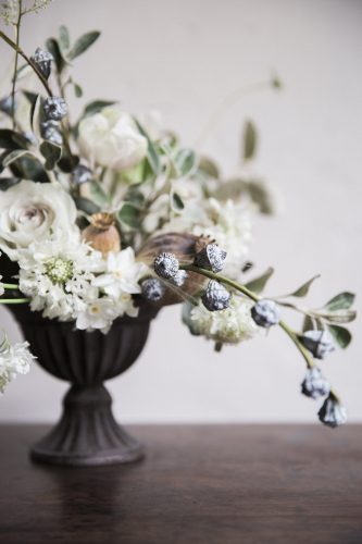 jay archer floral designs of whites and greys in a dark urn