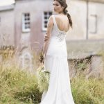 bridal portriat outside in the gardens of pennard house wearing a gown from luellas bridal