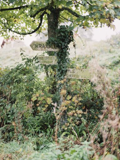 the countrside at pennard house with quint wooden signage