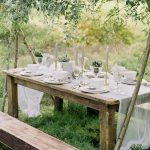 table setting styling for a fine art wedding outside in a garden setting with greys and whites