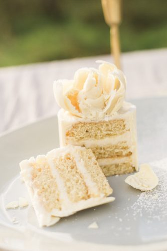 delicious white cake cut in half with creamy layers by the natural cake company