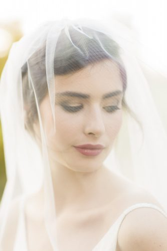 bridal portrait under her veil by Britten