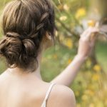 bride with loose braid and bun hairstyle