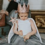 baby girl wearing a rose gold sequin crown with matching wand and grey tutu
