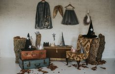 collection of pieces by fable heart displayed on vintage cases chairs and trunks