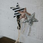 three different wands with sequins or stripes