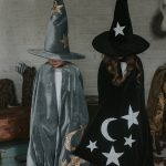 two children wearing the wizard cloaks in grey and black