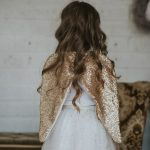 back of the little girl wearing the pretty gold sequin wings
