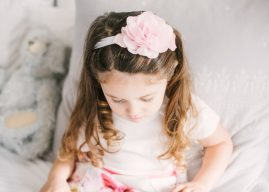 little girl wearing a rose hair accessory